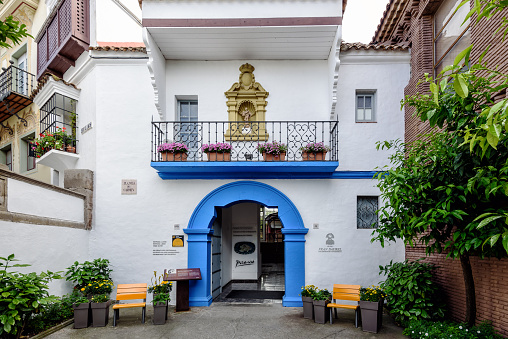 Blue arch as entrance to Picasso museum in Traditional Spanish village in Barcelona town
