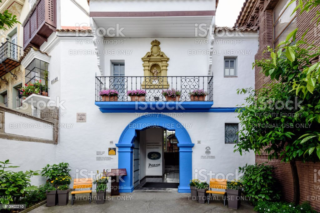 Blue arch as entrance to Picasso museum in Traditional Spanish village in Barcelona town stock photo