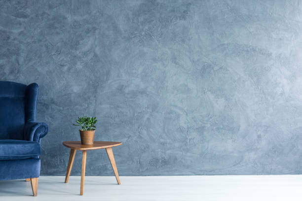 Blue armchair and wood side table stock photo
