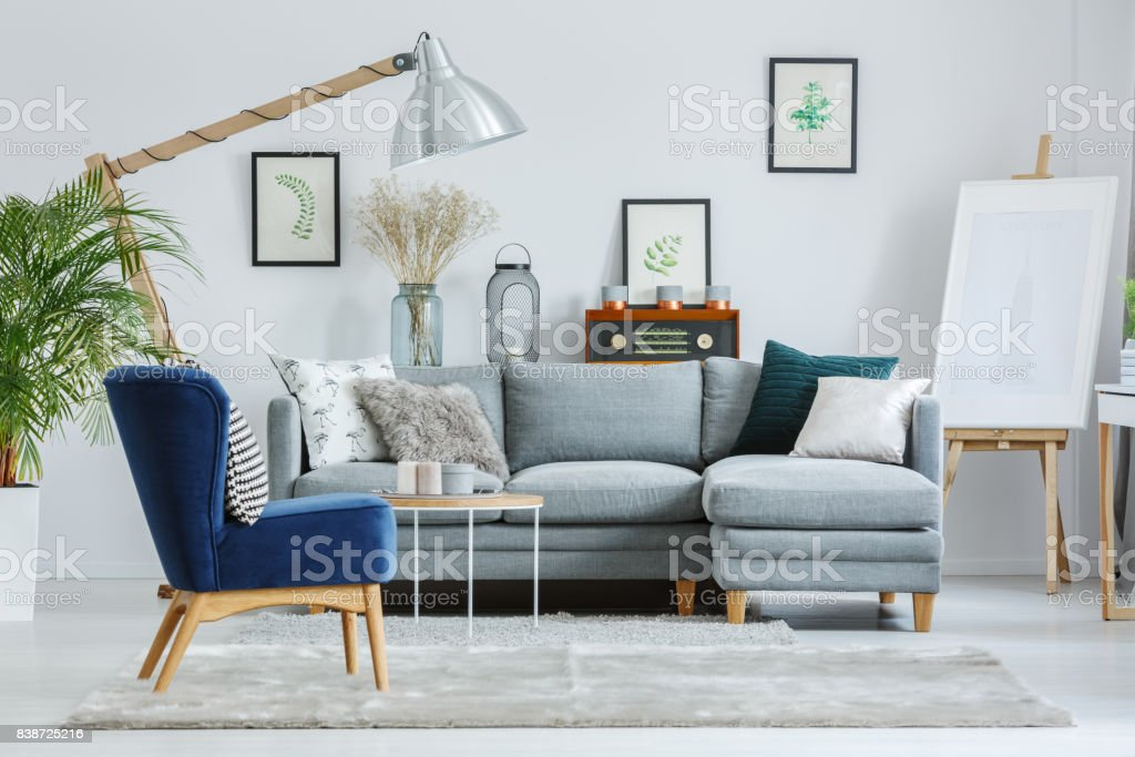 Blue armchair on grey carpet stock photo