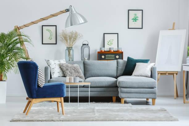 Blue armchair on grey carpet stock photo