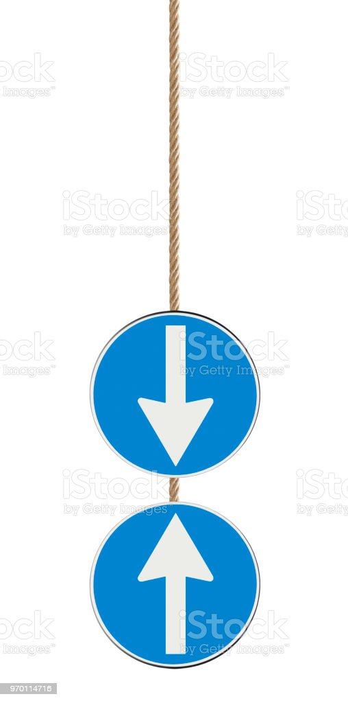 Blue arrow sign isolated on white background hanging from a rope indicating to go ahead or back - concept image stock photo