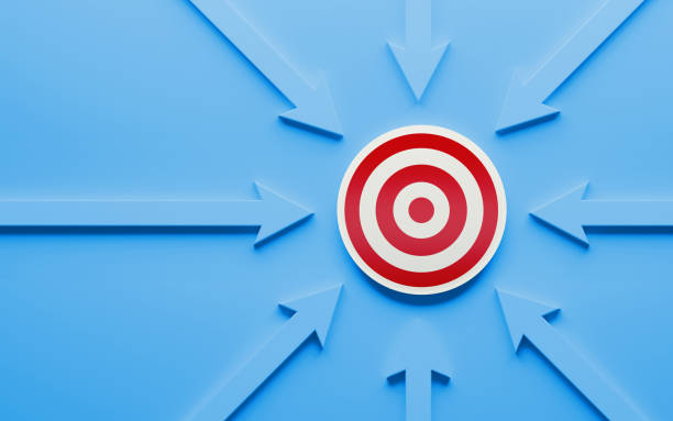 Blue Arrows Pointing A Red Target stock photo