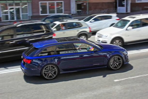 Blue Audi RS6 Avant C7 in motion. stock photo