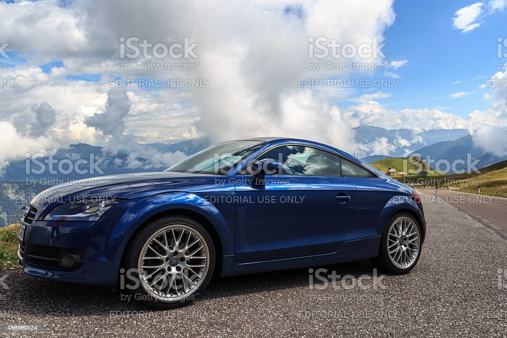 Blue Audi TT at the mountain pass Jaufenpass, Alps stock photo