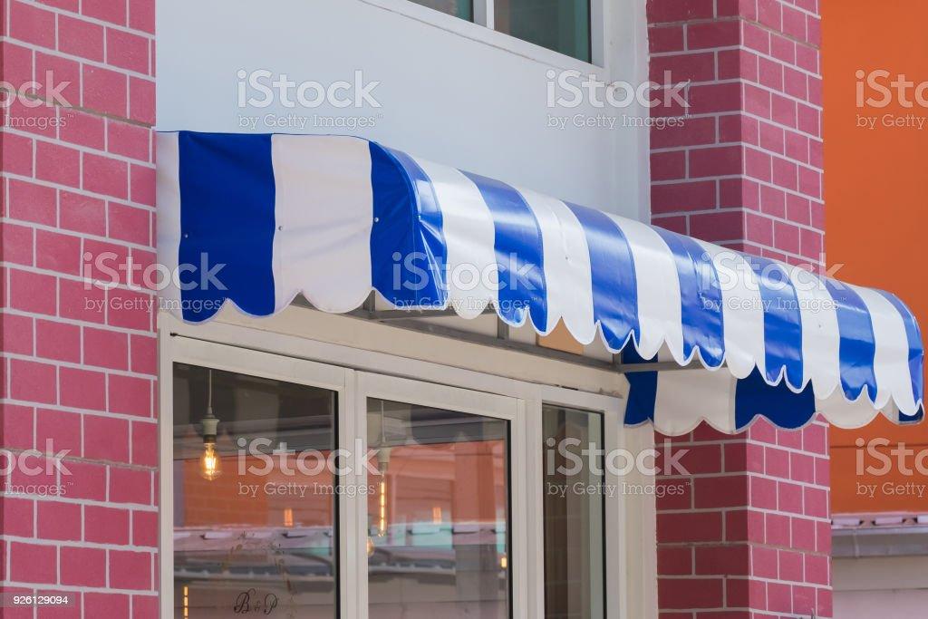 blue awning stock photo