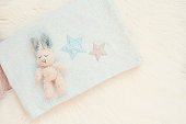 Blue Baby Blanket And Bunny Toy On A White Fur Carpet. Baby Mockup. Newborn Concept. Baby Boy Shower Invitation