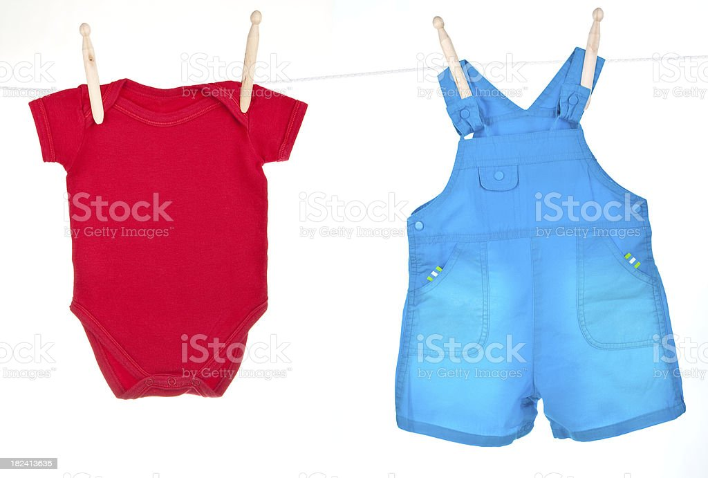 Blue baby overalls and red t-shirt hanging on a clothesline royalty-free stock photo