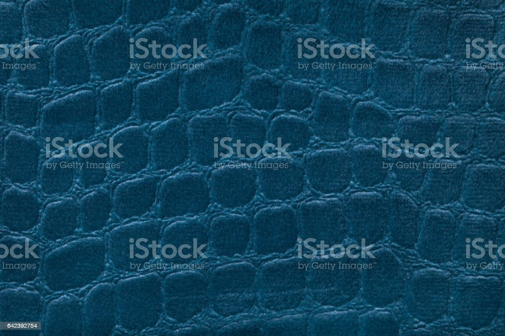 Blue background from a soft upholstery textile material, closeup. stock photo
