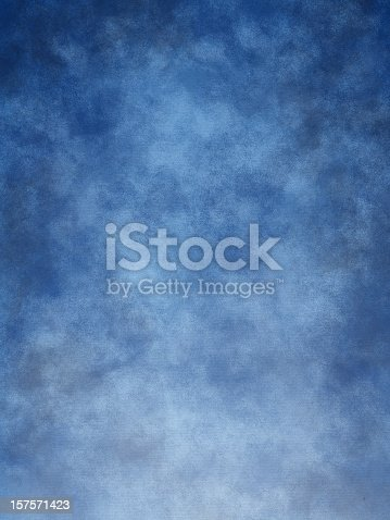 Mottled blue muslin type background.