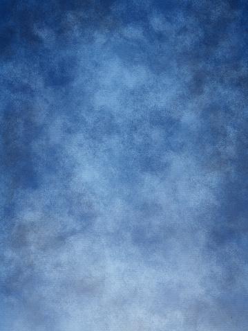Mottled blue muslin type background.
