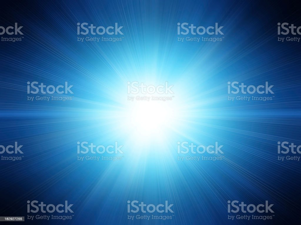 A blue background with a white flash royalty-free stock photo