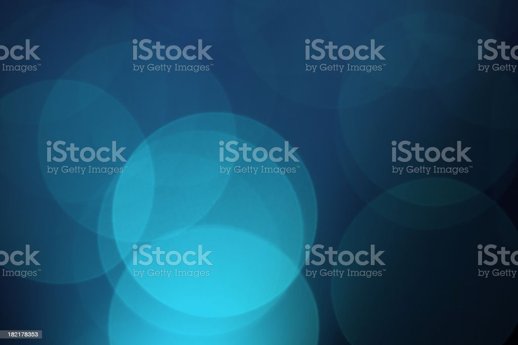 Blue background with overlapping circles of shades of blue  stock photo