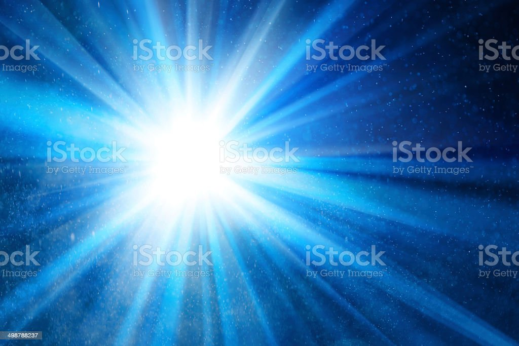 blue background with ray of light stock photo