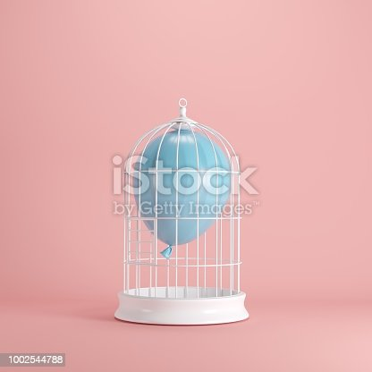 903520476 istock photo Blue balloon floating in white cage on pastel pink background. minimal idea concept. 1002544788