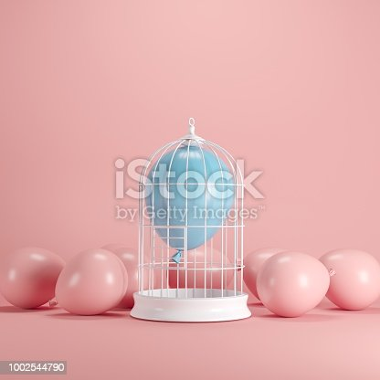 903520476 istock photo Blue balloon floating in white cage on pastel pink background. minimal idea concept. 1002544790