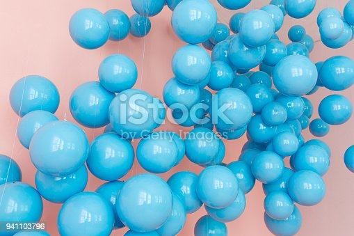 945748362 istock photo blue balloons, blue bubbles on pink background. Modern punchy pastel colors. Dream fantasy concept 941103796