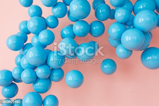945748362 istock photo blue balloons, blue bubbles on pink background. Modern punchy pastel colors 943601480