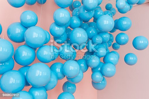945748362 istock photo blue balloons, blue bubbles on pink background. Modern punchy pastel colors. Dream fantasy concept 946807912