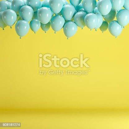 903520476 istock photo Blue balloons floating in yellow pastel background room studio. minimal idea creative concept. 928181274