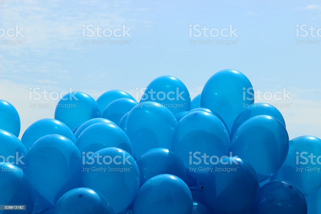 blue balloons on the sky background stock photo