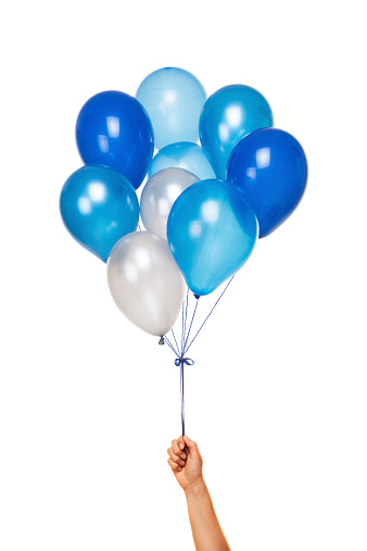 Blue Balloons in hand isolated on white background