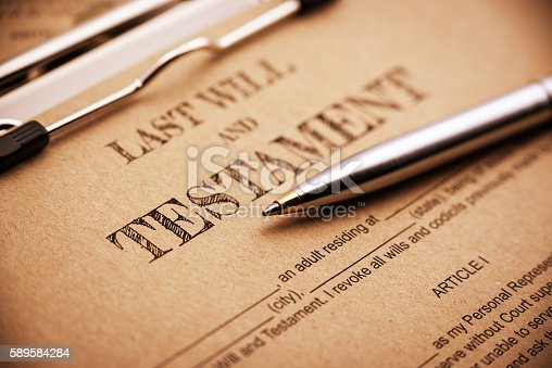 584597964 istock photo Blue ballpoint pen and a last will and testament. 589584284