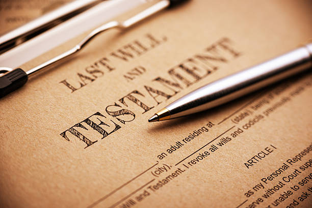blue ballpoint pen and a last will and testament. - will stock photos and pictures