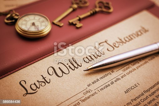 584597964 istock photo Blue ballpoint pen and a last will and testament. 589584436