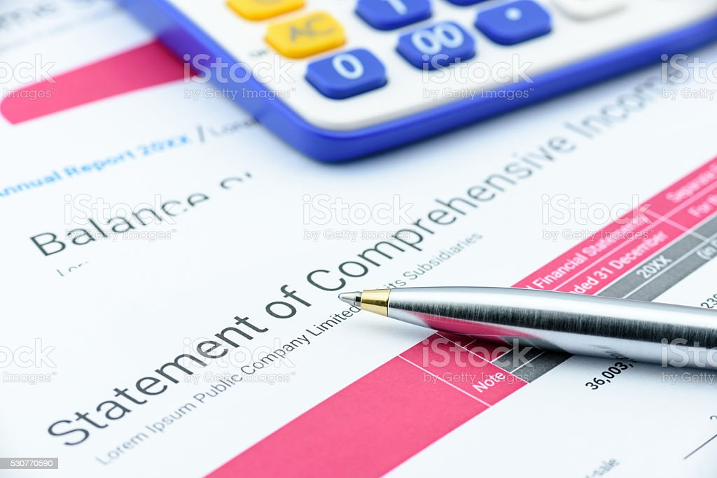 Blue ballpoint pen on a company's statement of comprehensive income. stock photo