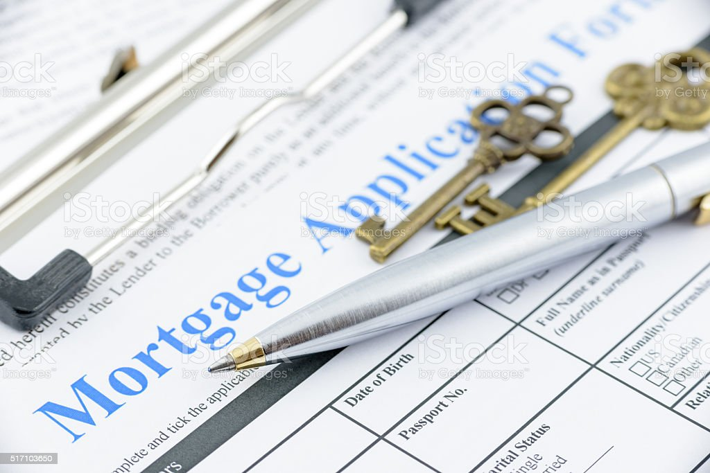 Blue ballpoint pen on a mortgage application form. stock photo