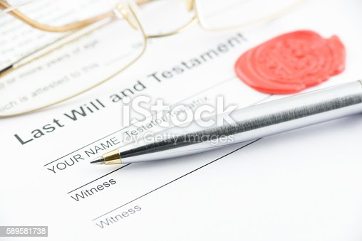 584597964 istock photo Blue ballpoint pen on last will and testament. 589581738