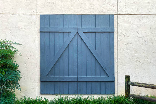 blue barn door white stone building stock photo