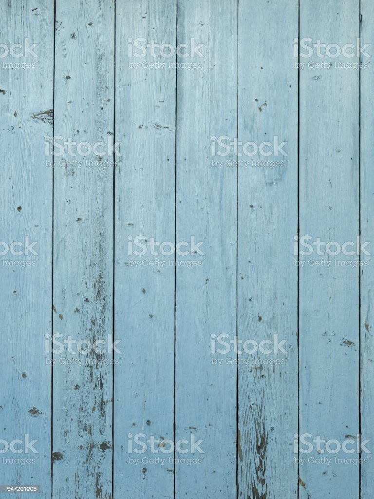Blue barn wood wall with peeling paint stock photo
