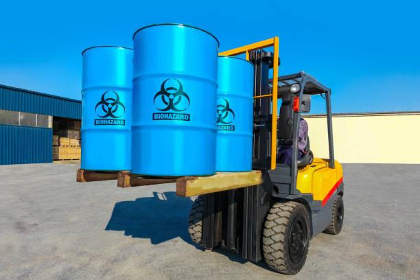 Blue barrels on forklift truck. Blue barrels on forklift truck. Import export cargo concept. toxic waste stock pictures, royalty-free photos & images