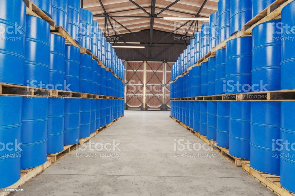 Blue barrels on wooden pallets in warehouse Blue barrels on wooden pallets in warehouse Barrel Stock Photo
