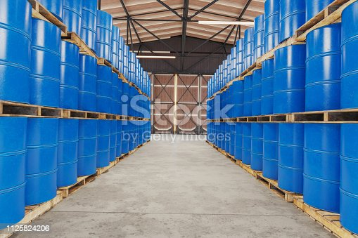 Blue barrels on wooden pallets in warehouse
