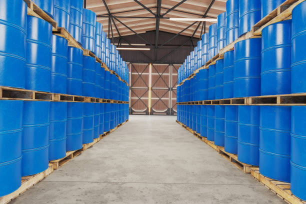 Blue barrels on wooden pallets in warehouse stock photo