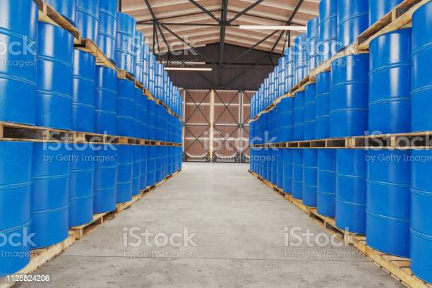Blue Barrels On Wooden Pallets In Warehouse Stock Photo - Download Image Now