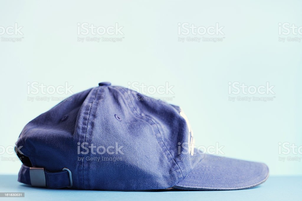 Blue baseball cap against white background. royalty-free stock photo