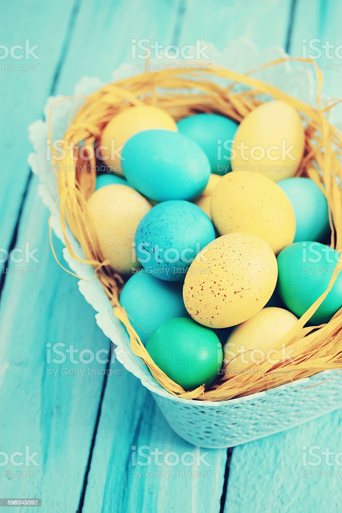blue basket of eggs, tinted royalty-free stock photo