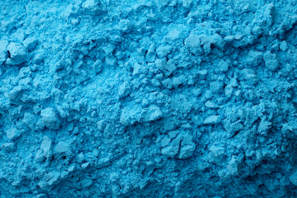 Blue bath bombs dry mixture background Blue bath bombs dry mixture background, top view colored powder stock pictures, royalty-free photos & images