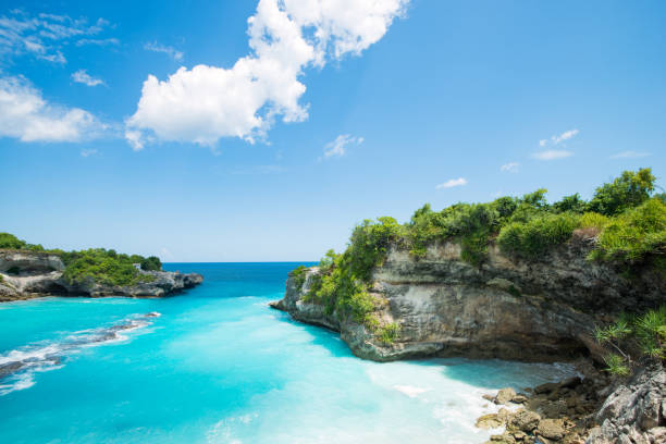 blue bay lagoon near Bali in Indonesia, Nusa Penida beautiful landscape at Nusa Penida near Bali in Indonesia blue lagoon indonesia stock pictures, royalty-free photos & images