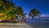 Illuminated jetty and sea-villas at night - Kuda Huraa - Maldives.