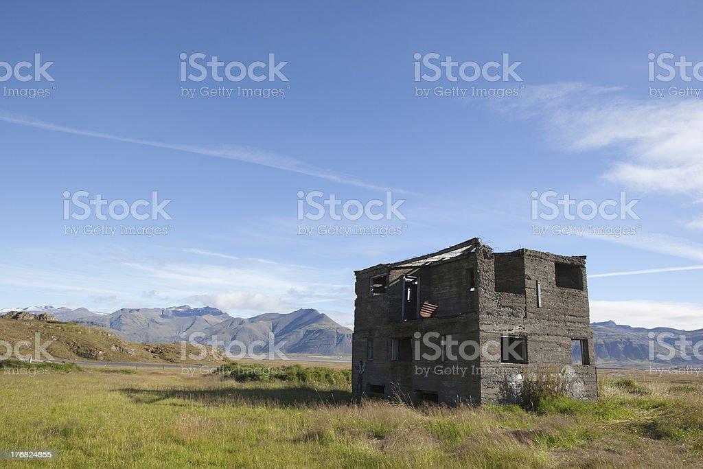 Blue beautiful sky mountain and samll  obsolete farm @ Iceland royalty-free stock photo