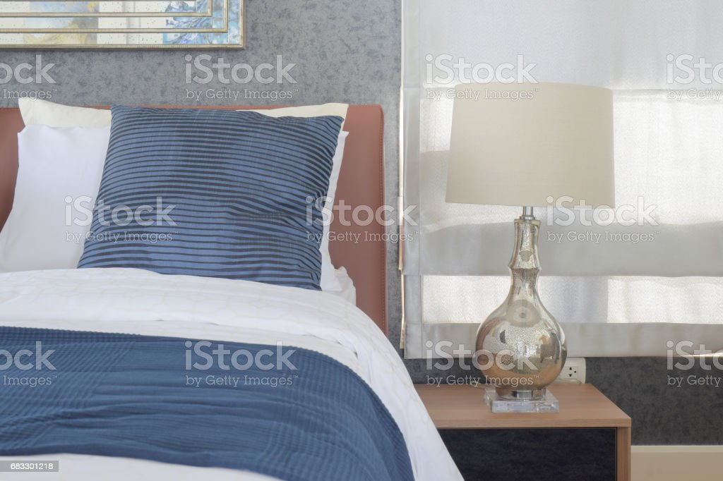 Blue bedding style and classic style white reading lamp in bedroom foto stock royalty-free