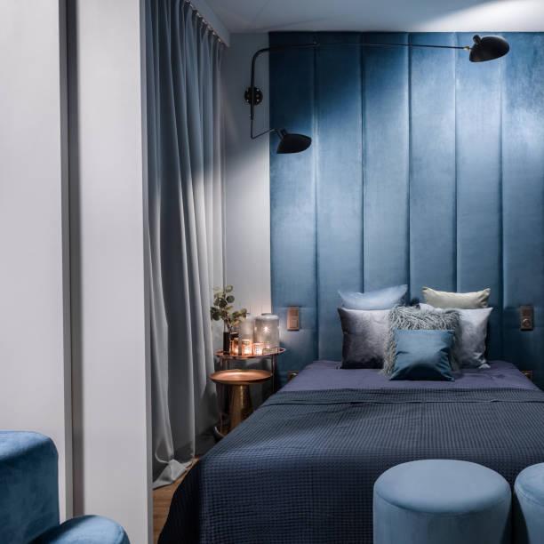 Blue bedroom behind sliding doors stock photo