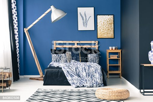 508860888 istock photo Blue bedroom with gold accents 840802536