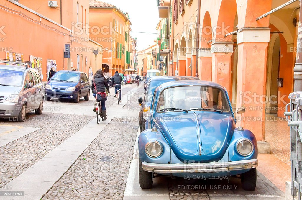 blue beetle parked in via del pratello in Bologna royalty-free stock photo