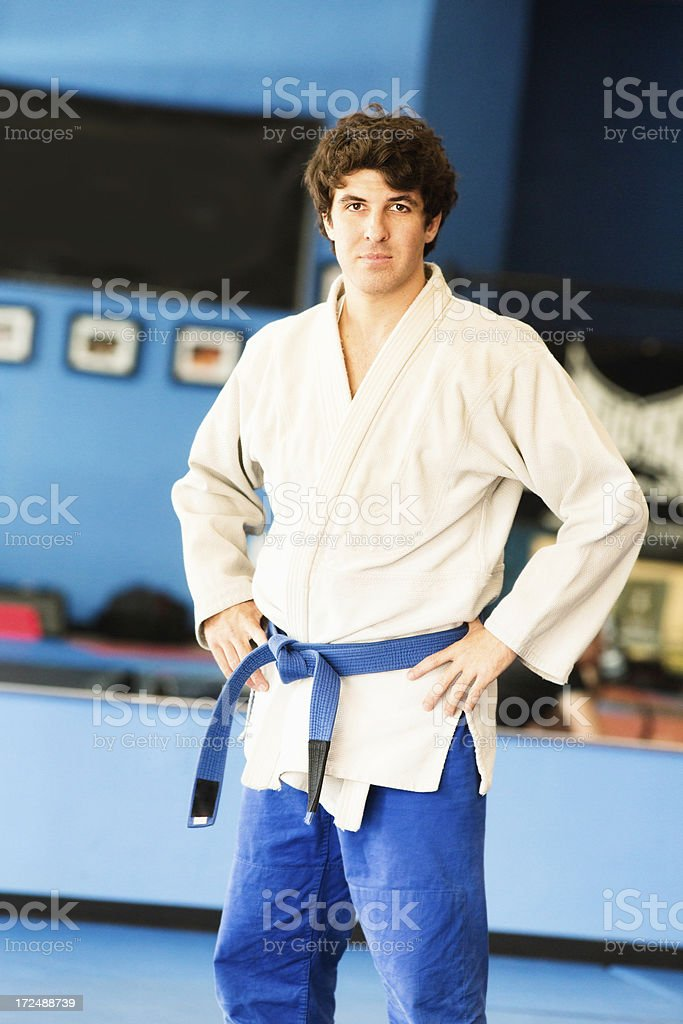 Blue Belt Martial Arts Fighter in Gi Hands on Hips royalty-free stock photo